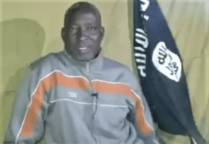 The Rev. Lawan Andimi pleads for help on video released on Jan. 5, 2020. (Screenshot from video, Morning Star News)