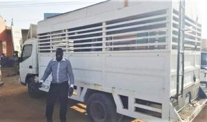 The Rev. Philemon Hassan Kharata with Baptist church truck confisicated in 2012. (Facebook)