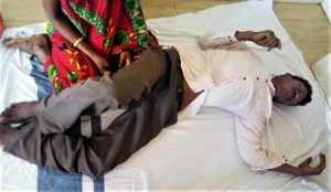 Kama Sodi before his wife after animist villagers beat him in Odisha state, India. (Morning Star News)