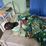 Emmanuel Kure at Enos Hospital, Miango, after Muslim Fulani herdsmen shot and killed him in Plateau state, Nigeria. (Morning Star News)