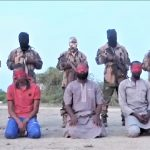 Islamic State in West Africa Province militants before execution of aid workers in Borno, Nigeria. (Screenshot)