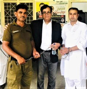 Asif Pervaiz (right) with attorney Saiful Malook (center) at prison. (Morning Star News)