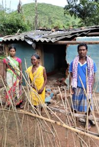 Damaged home of Kanduru Muduli (right), with his mother and daughter in Badaguda, Odisha state, India. (Morning Star News)