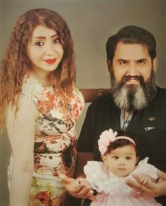 Maryam Falahi, Sam Khosravi and adopted daughter. (MEC)
