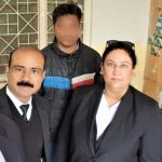 Attorney Aneeqa Maria (right) and accused Christian Haroon Ayub Masih, face obscured for security reasons. (Morning Star News photo courtesy of The Voice Society)