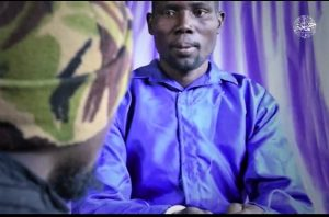 Screenshot of Pastor Bulus Yikura with ISWAP captor from prior video released in January 2021. (Morning Star News)