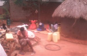 Surviving wife and children mourn the May 3, 2021 killing of pastor Thomas Chikooma in eastern Uganda. (Morning Star News)