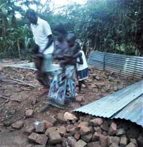 Louis Levi Baula and family after Muslim relatives destroyed their home in eastern Uganda on May 23, 2021. (Morning Star News)