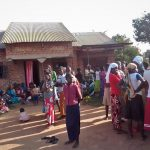 Mourners at the home of the slain Tabiruka Tefiiro in Bupalama village, eastern Uganda. (Morning Star News)